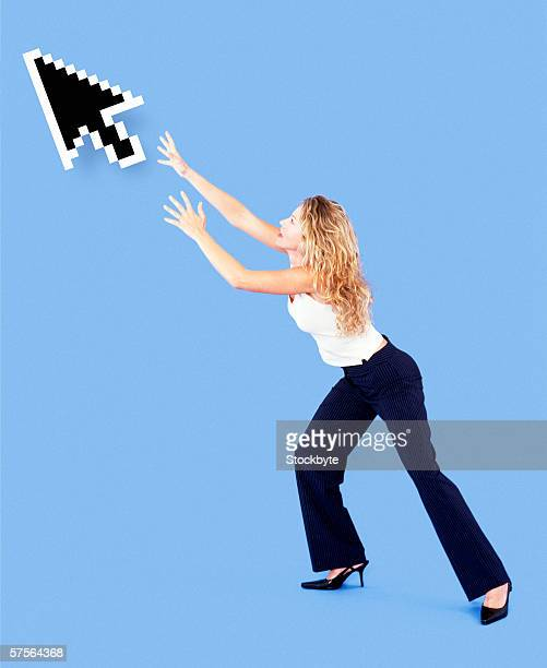 side profile of a woman reaching out for the computer cursor against a blue background