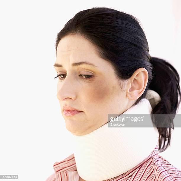 Side profile of a woman wearing a neck brace