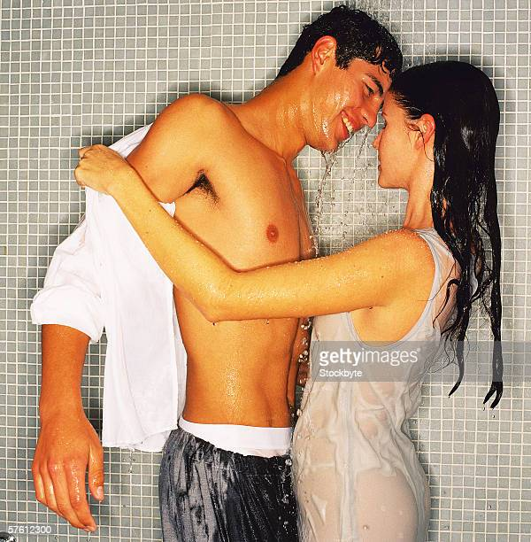 Side profile of a young couple showering together