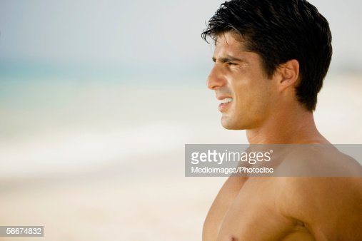 side profile of a young man on the beach stock photo. Black Bedroom Furniture Sets. Home Design Ideas