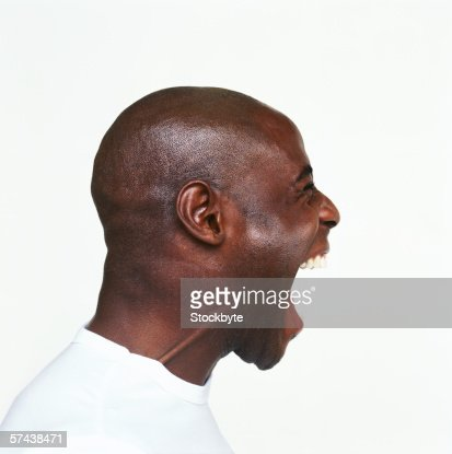 side profile of a young man screaming : Photo