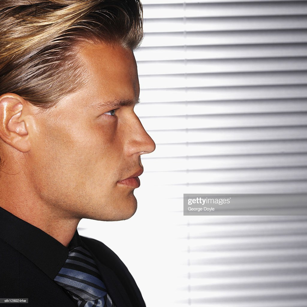 side profile of a young mans face stock photo getty images