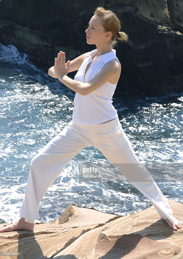 side profile of a young woman practicing yoga stock foto getty images. Black Bedroom Furniture Sets. Home Design Ideas