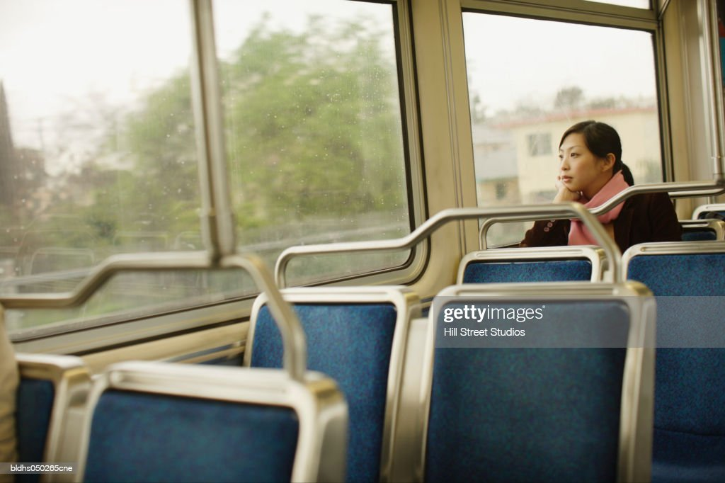 Side profile of a young woman sitting in a train