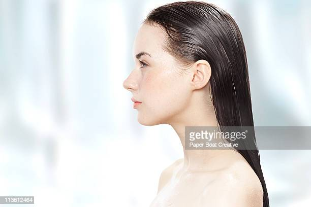 Side profile of a young woman with her hair wet