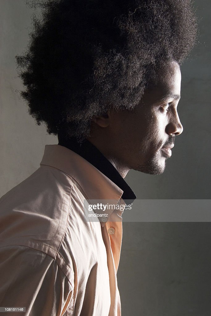 side profile of man with afro hairstyle low key stock. Black Bedroom Furniture Sets. Home Design Ideas