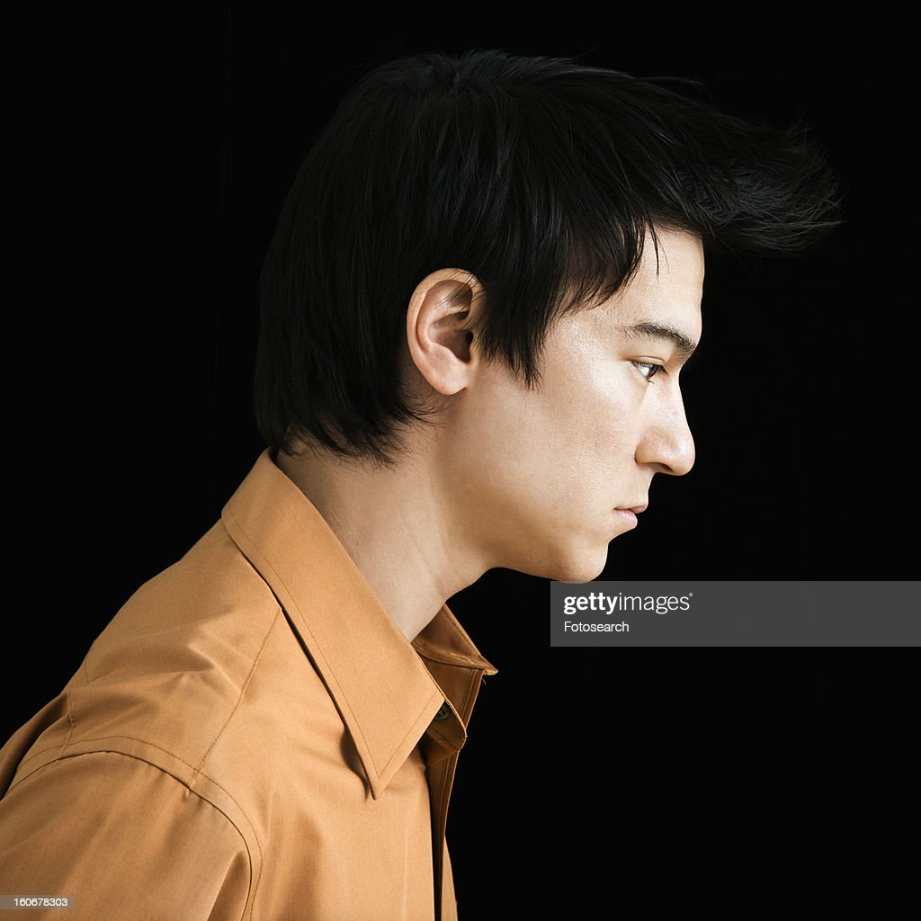 side profile of serious young man stock photo getty images. Black Bedroom Furniture Sets. Home Design Ideas