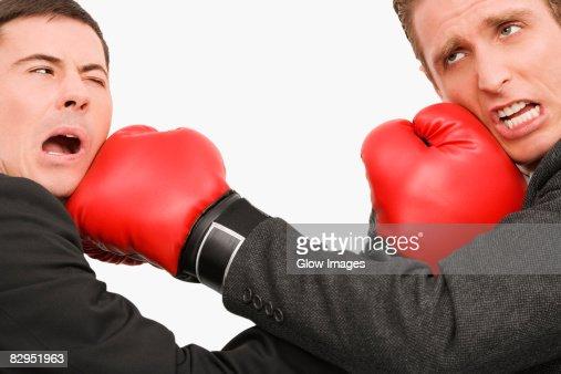 side profile of two businessmen boxing stock foto getty images. Black Bedroom Furniture Sets. Home Design Ideas