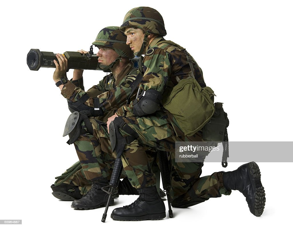 Side profile of two soldiers holding a grenade launcher
