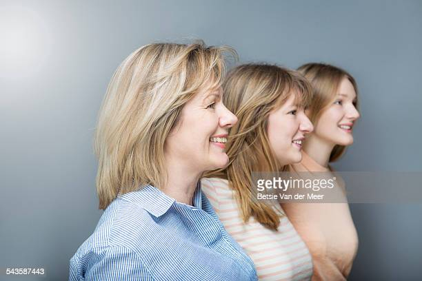 Side shot of mother and daughters in studio.