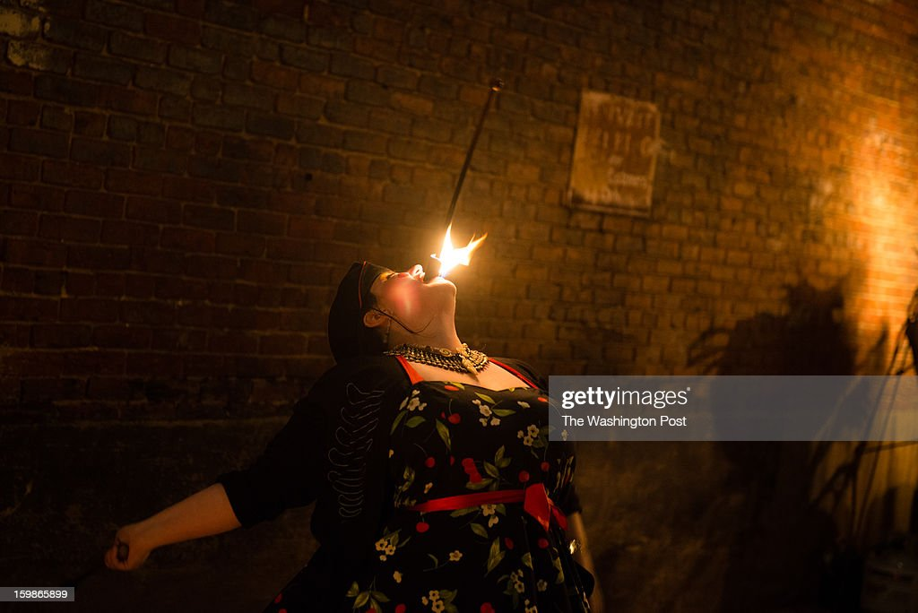 Side show performer, Mab Just Mab, 41, of McLean, swallows fire at Gallery O on H. The 2013 Artist's Inaugural Ball featured live music, fire performances, Djs, dancing, a hookah lounge and more. It was spread among six areas in the Rock and Roll Hotel and Gallery O on H. A portion of the proceeds went to local charities, Miriam's Kitchen and One Common Unity. The hosts were Mischief, Rogue Wave Project, Artomatic, and Meso Creso.