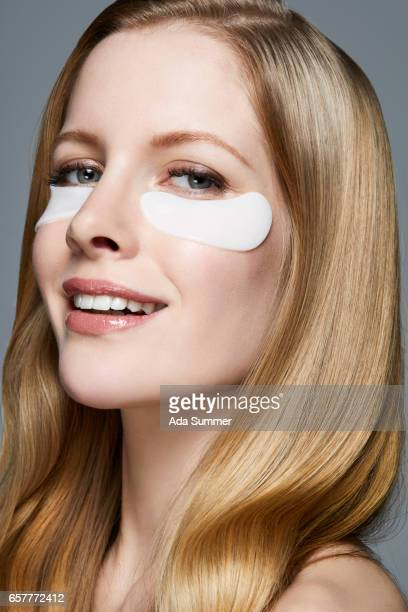 side view close-up of a beautiful woman with gel eye mask