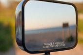 Beach reflection through the rear view mirror