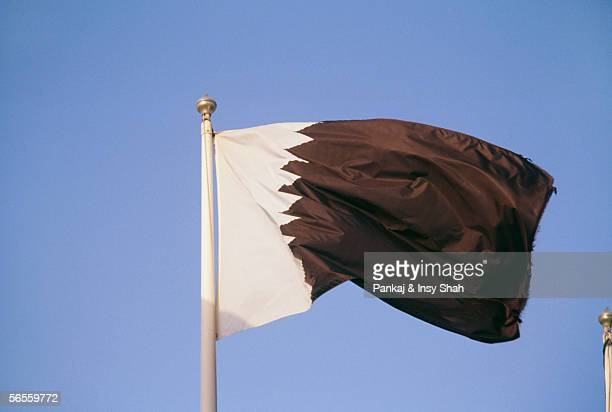 Side view of a flag fluttering due to breeze.