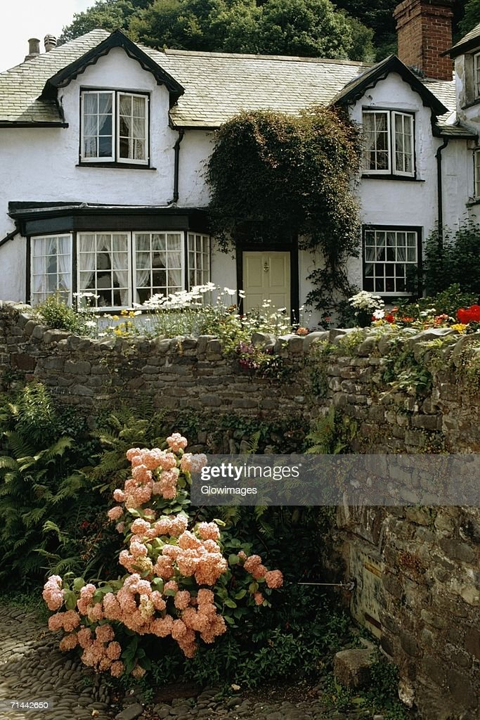 Side View Of A House With A Garden In Its Front England