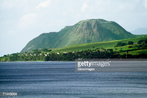 Side view of a lush mountain from a vast sea, St. Kitts, Leeward Islands, Caribbean