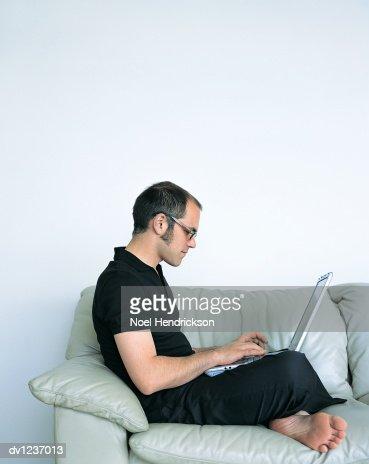 Man Sitting Cross Legged Side View Side View Of A Man Sit...