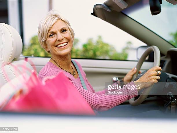 Side view of a mature woman driving
