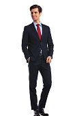 side view picture of a young smiling business man looking away , standing with hand in pocket on white background