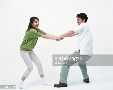 Side view of a woman pulling her husband's hand