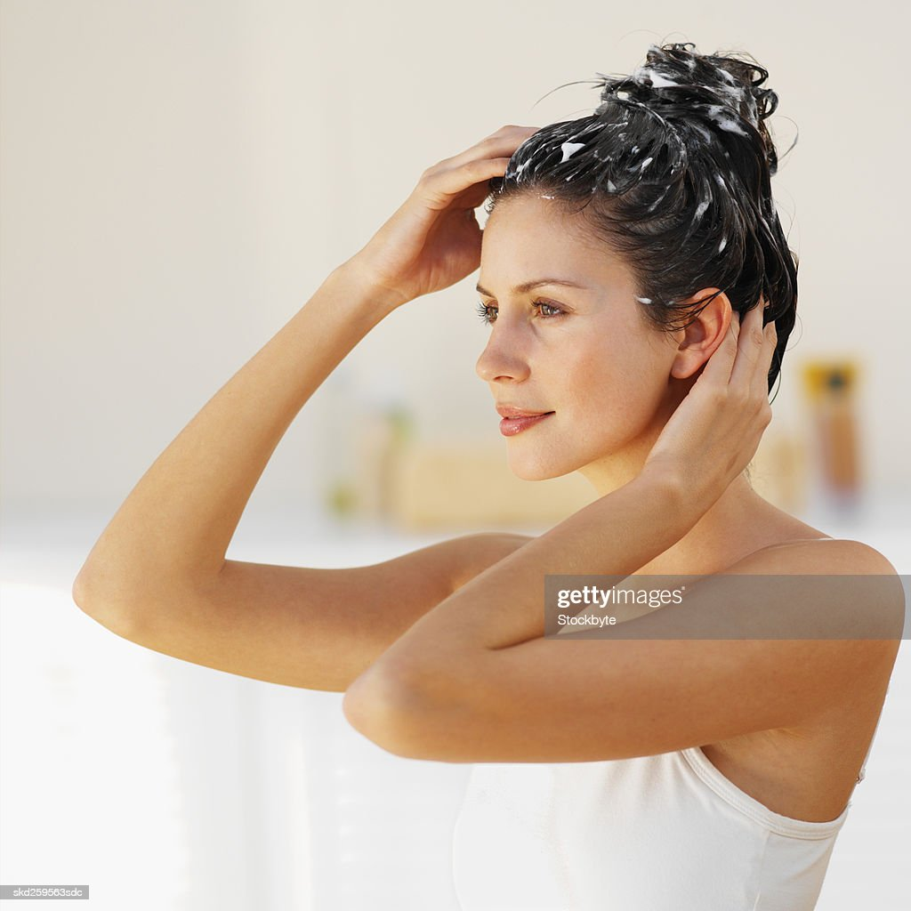 Side view of a woman washing her hair