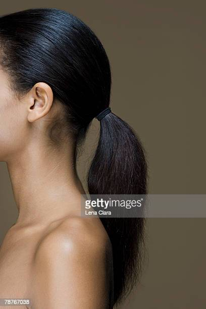Side view of a woman with long black hair