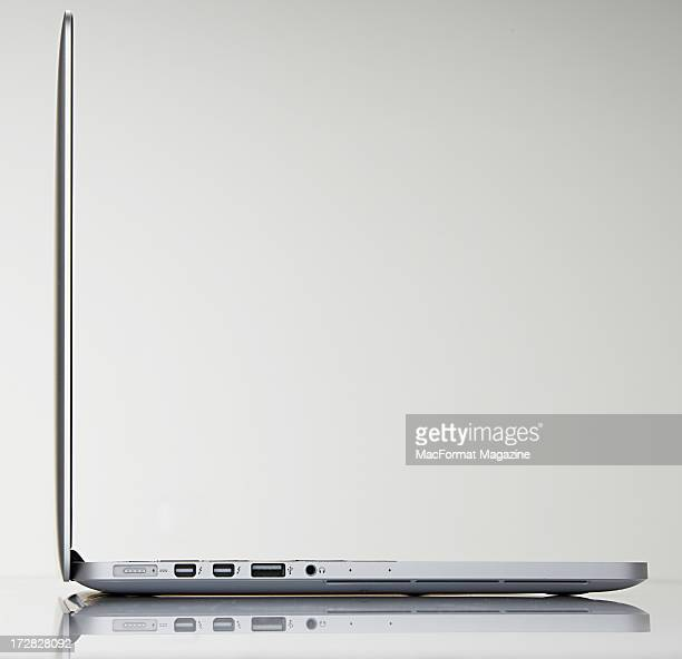 A side view of an Apple 13' MacBook Pro laptop with Retina display photographed during a studio shoot for MacFormat Magazine November 20 2012