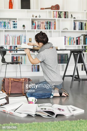 Working In Home Office side view of architect working in home office stock photo | getty