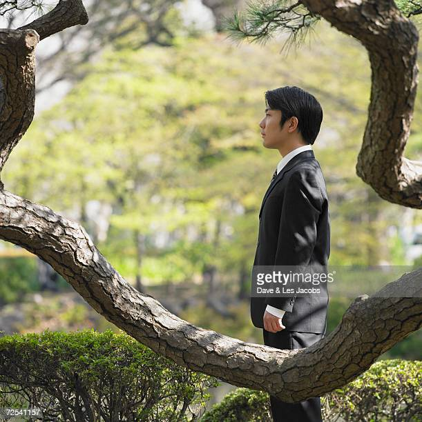Side view of Asian businessman in park