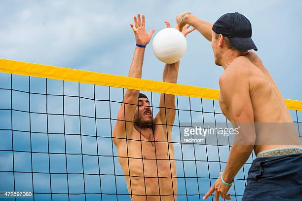 Side View of Attractive Beach Volley Action on the Net