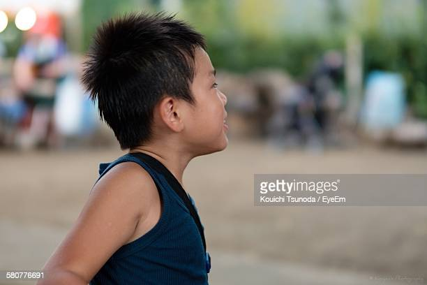Side View Of Boy At Beach