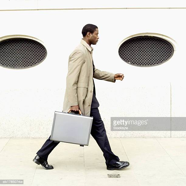 side view of businessman holding briefcase