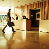 Side view of businessman walking past hotel reception