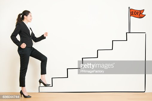 Side view of businesswoman climbing the stairs of drawing : Stock Photo