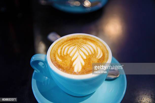 Side view of coffee cup on table