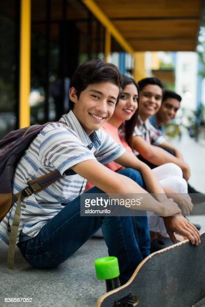 Side view of college students sitting in a row