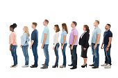 Full length side view of creative business people standing in row against white background