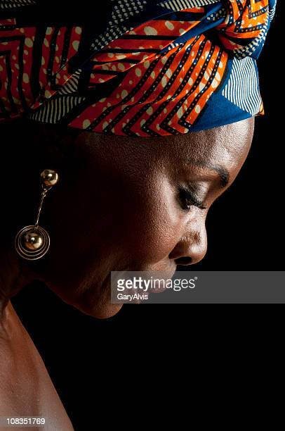 Side view of expressive African  woman in traditional headgear