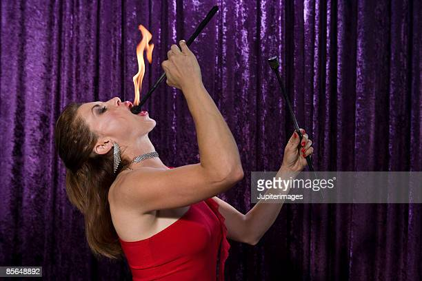 Side view of fire eater
