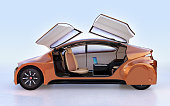 Side view of golden autonomous vehicle on light blue background. The doors opened and there is a laptop computer on the table. 3D rendering image.