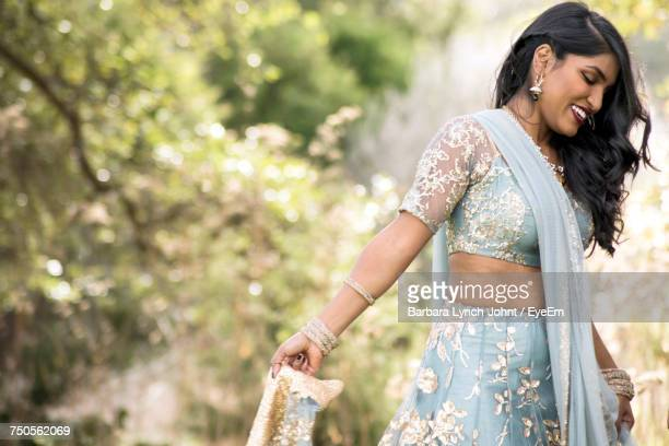 Side View Of Happy Woman In Traditional Clothing