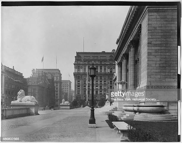Side view of lion statues and facade of the New York Public Library main branch New York New York 1895