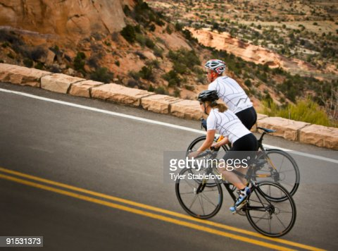 side view of male and female cyclist biking stock foto getty images. Black Bedroom Furniture Sets. Home Design Ideas