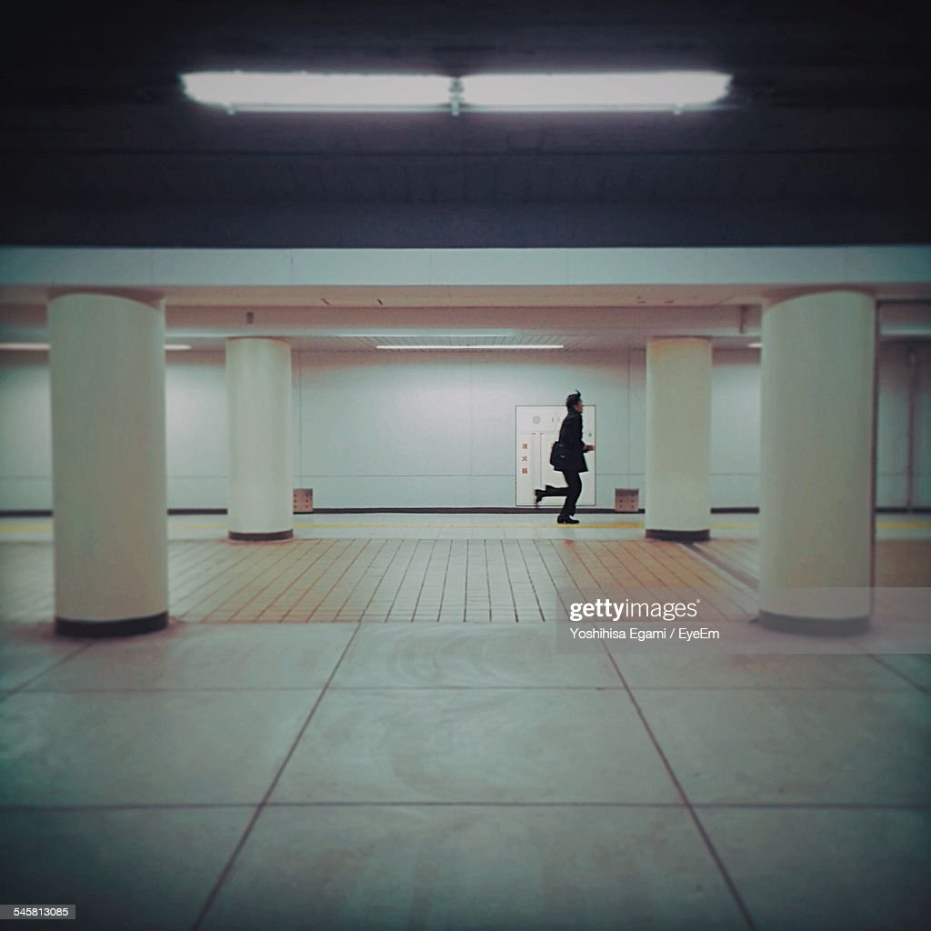 Side View Of Man Running In Subway