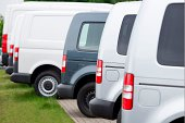 Side view of New Vans in a row