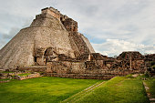 Side view of Pyramid of the Magician ruins in Uxmal on overcast day