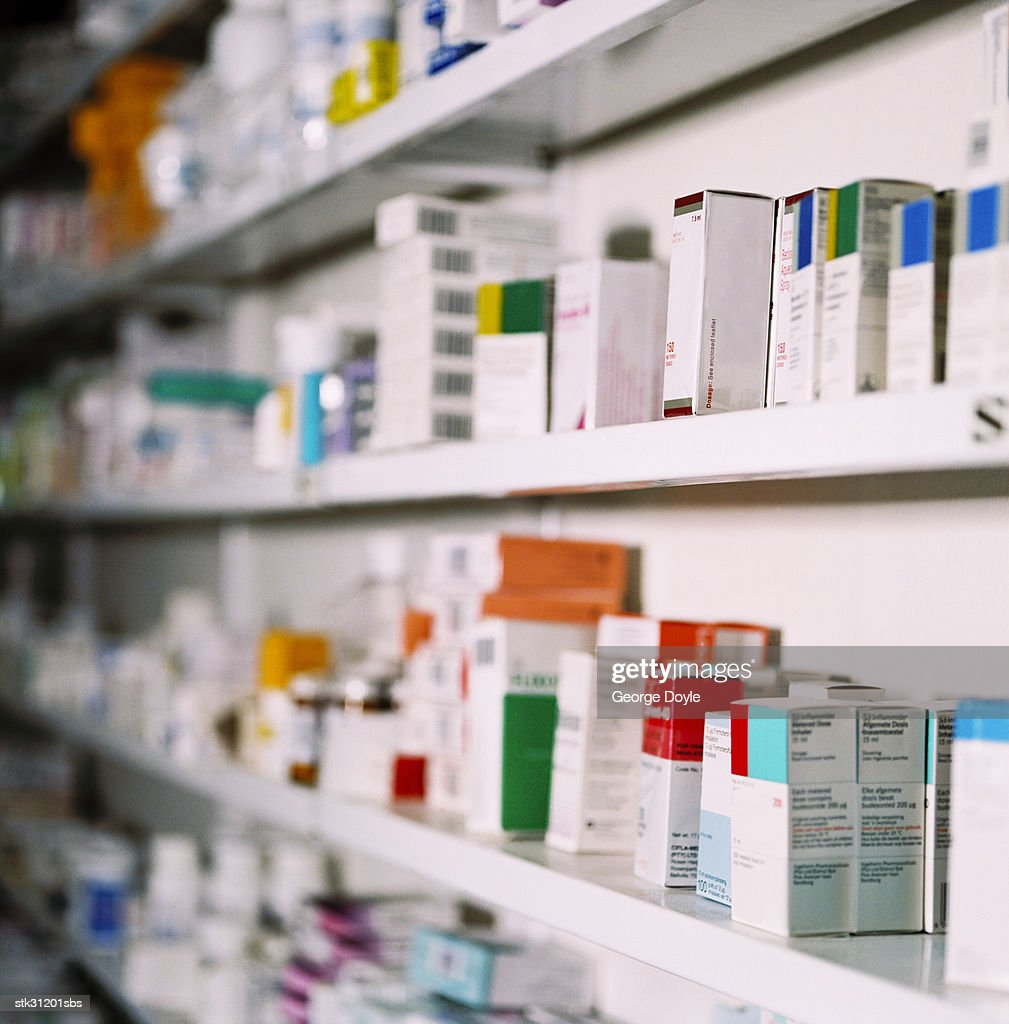 side view of rows of medicines on a shelf : Stock Photo