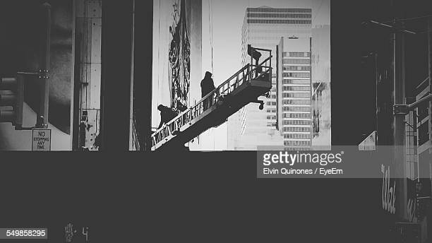 Side View Of Silhouette People Walking Up Stairs