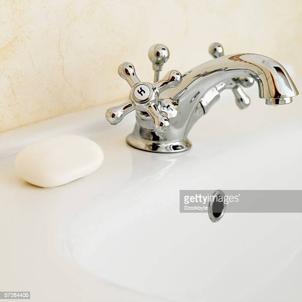 Side view of sink showing tap and bar of soap