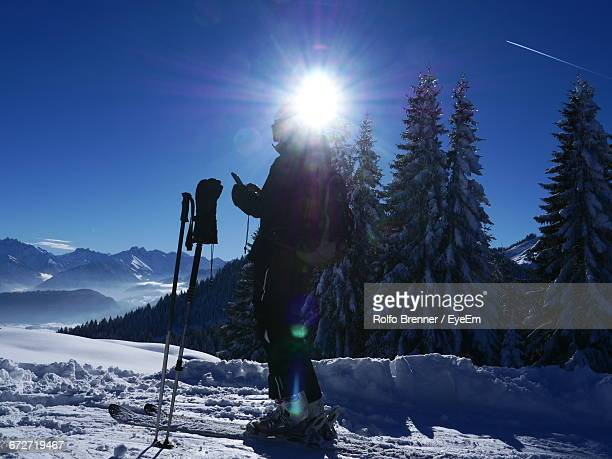 Side View Of Skiing On Snow Landscape